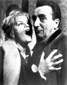 Director Mario Bava succumbs to a vampire's kiss on the set of Black Sabbath (1963).
